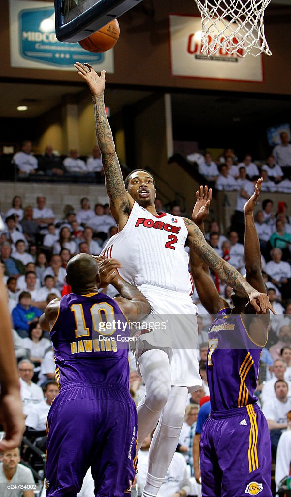 <a gi-track='captionPersonalityLinkClicked' href=/galleries/search?phrase=Greg+Whittington&family=editorial&specificpeople=7636075 ng-click='$event.stopPropagation()'>Greg Whittington</a> #2 from the Sioux Falls Skyforce lays the ball up past <a gi-track='captionPersonalityLinkClicked' href=/galleries/search?phrase=Justin+Hawkins&family=editorial&specificpeople=171558 ng-click='$event.stopPropagation()'>Justin Hawkins</a> #10 and <a gi-track='captionPersonalityLinkClicked' href=/galleries/search?phrase=Andre+Ingram&family=editorial&specificpeople=4140670 ng-click='$event.stopPropagation()'>Andre Ingram</a> #7 from the Los Angeles Defenders during the NBA D-League Finals Game 2 at the Sanford Pentagon April 26, 2016 in Sioux Falls, South Dakota.