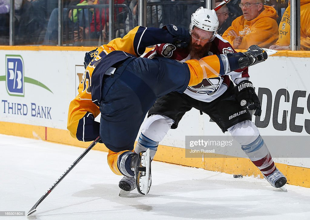 <a gi-track='captionPersonalityLinkClicked' href=/galleries/search?phrase=Greg+Zanon&family=editorial&specificpeople=567162 ng-click='$event.stopPropagation()'>Greg Zanon</a> #4 of the Colorado Avalanche battles behind the net against <a gi-track='captionPersonalityLinkClicked' href=/galleries/search?phrase=Paul+Gaustad&family=editorial&specificpeople=577980 ng-click='$event.stopPropagation()'>Paul Gaustad</a> #28 of the Nashville Predators during an NHL game at the Bridgestone Arena on April 2, 2013 in Nashville, Tennessee.