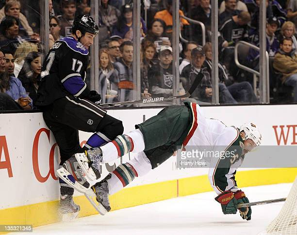 Greg Zanon of the Minnesota Wild is knocked to the ice from a collision with Ethan Moreau of the Los Angeles Kings during the second period at...