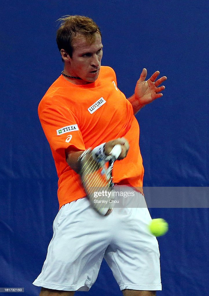 <a gi-track='captionPersonalityLinkClicked' href=/galleries/search?phrase=Grega+Zemlja&family=editorial&specificpeople=3098293 ng-click='$event.stopPropagation()'>Grega Zemlja</a> of Slovenia plays a forehand shot against Pablo Andurjar of Spain during day two Round one of the 2013 Malaysian Open at Putra Stadium on September 24, 2013 in Kuala Lumpur, Malaysia.