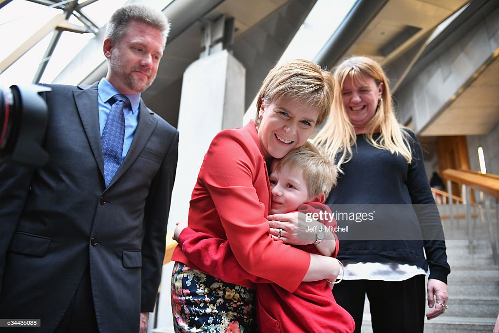 Gregg, Kathryn and Lachlan Brain meet Scotland's First Minister Nicola Sturgeon at the Scottish Parliament garden lobby on May 26, 2016 in Edinburgh, Scotland. and Kathryn Brain, an Australian couple with Scottish ancestry, and their seven year old son Lachlan are facing deportation after the visa they arrived on was retrospectively cancelled by the Home Office. They arrived in 2011 under The Highland Homecoming Initiative run by the Scottish Government and backed by the Home Office to help re-populate the Highlands but the scheme was shut by the Home Office in 2012. The Brain family have settled in Dingwall where Lachlan is a pupil at the local Gaelic-speaking primary school. Their community, councillors and MSP's have rallied round in support of their bid to stay in the Highlands. .