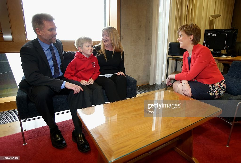 Gregg, Kathryn and Lachlan Brain meet Scotland's First Minister <a gi-track='captionPersonalityLinkClicked' href=/galleries/search?phrase=Nicola+Sturgeon&family=editorial&specificpeople=2582617 ng-click='$event.stopPropagation()'>Nicola Sturgeon</a> at the Scottish Parliament garden lobby on May 26, 2016 in Edinburgh, Scotland. and Kathryn Brain, an Australian couple with Scottish ancestry, and their seven year old son Lachlan are facing deportation after the visa they arrived on was retrospectively cancelled by the Home Office. They arrived in 2011 under The Highland Homecoming Initiative run by the Scottish Government and backed by the Home Office to help re-populate the Highlands but the scheme was shut by the Home Office in 2012. The Brain family have settled in Dingwall where Lachlan is a pupil at the local Gaelic-speaking primary school. Their community, councillors and MSP's have rallied round in support of their bid to stay in the Highlands.