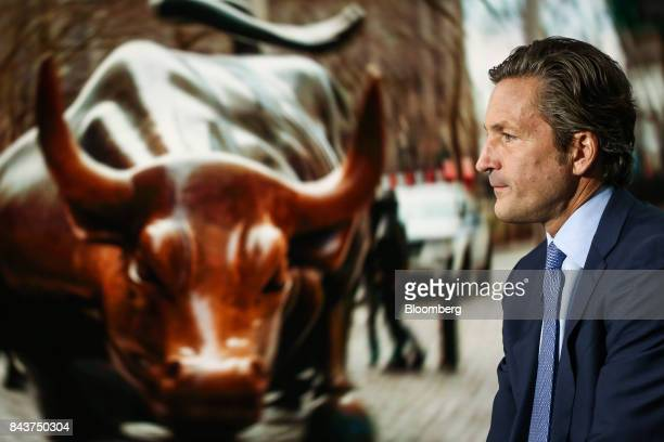 Gregg Lemkau cohead of investment banking for Goldman Sachs Co listens during a Bloomberg Television interview in New York US on Thursday Sept 7 2017...