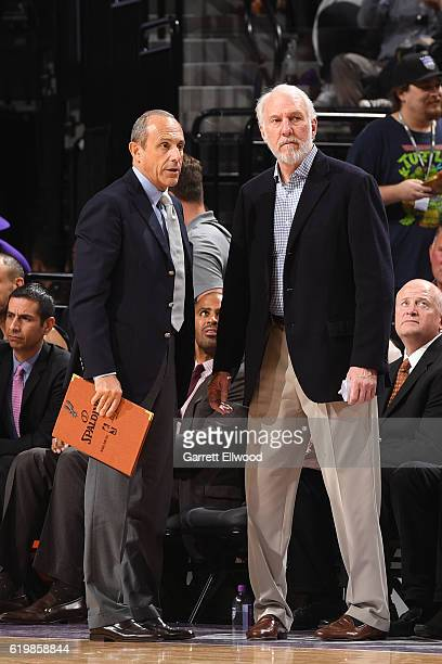Gregg Popovich and Ettore Messina of the San Antonio Spurs coach together during the game against the Sacramento Kings on October 27 2016 at the...