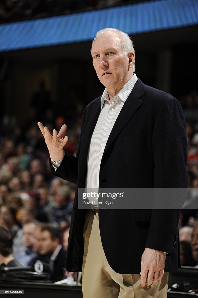 <a gi-track='captionPersonalityLinkClicked' href=/galleries/search?phrase=Gregg+Popovich&family=editorial&specificpeople=202904 ng-click='$event.stopPropagation()'>Gregg Popovich</a>, Head Coach of the San Antonio Spurs, calls a play during the game against the Cleveland Cavaliers at The Quicken Loans Arena on February 13, 2013 in Cleveland, Ohio.