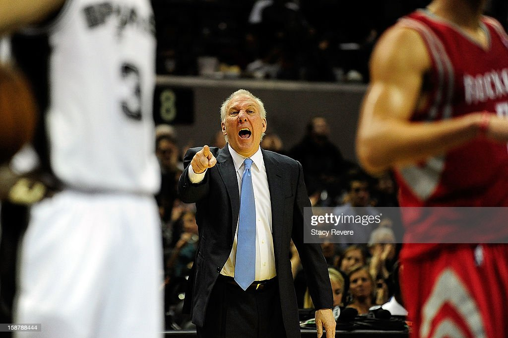 Gregg Popovich, head coach of the San Antonio Spurs, directs his players during a game against the Houston Rockets at AT&T Center on December 28, 2012 in San Antonio, Texas.