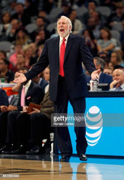Gregg Popovich head coach of the San Antonio Spurs gives instruction to his team during the game against the Memphis Grizzlies at ATT Center on...