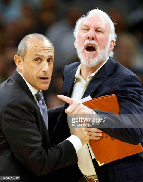 Gregg Popovich head coach of the San Antonio Spurs is restrained by assistant coach Ettore Messina after receiving his second technical during game...