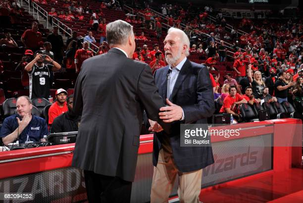 Gregg Popovich of the San Antonio Spurs and Mike D'Antoni of the Houston Rockets are seen after Game Six of the Western Conference Semifinals of the...