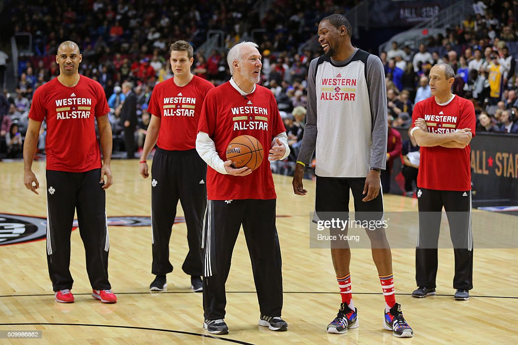 Gregg Popovich of the San Antonio Spurs coaches Kevin Durant #35 of the Oklahoma City Thunder during the NBA All-Star Practice as part of 2016 All-Star Weekend at the Ricoh Coliseum on February 13, 2016 in Toronto, Ontario, Canada.