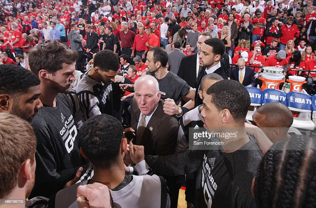 <a gi-track='captionPersonalityLinkClicked' href=/galleries/search?phrase=Gregg+Popovich&family=editorial&specificpeople=202904 ng-click='$event.stopPropagation()'>Gregg Popovich</a> of the San Antonio Spurs huddles up before Game Three of the Western Conference Semifinals against the Portland Trail Blazers during the 2014 NBA Playoffs on May 10, 2014 at the Moda Center in Portland, Oregon.