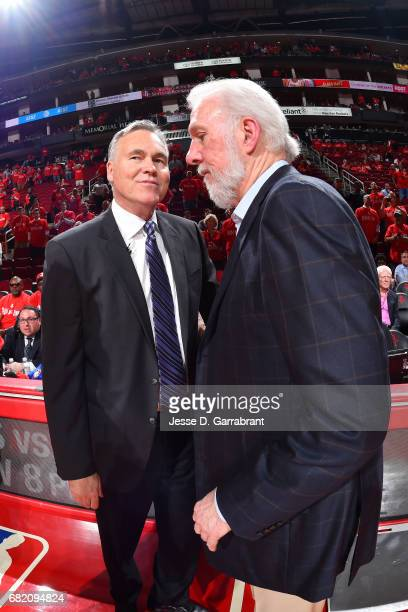 Gregg Popovich of the San Antonio Spurs shakes hands with Mike D'Antoni of the Houston Rockets after the game during Game Six of the Western...