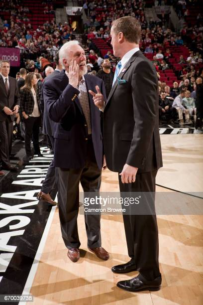 Gregg Popovich of the San Antonio Spurs talks to Terry Stotts of the Portland Trail Blazers before the game on April 10 2017 at the Moda Center in...