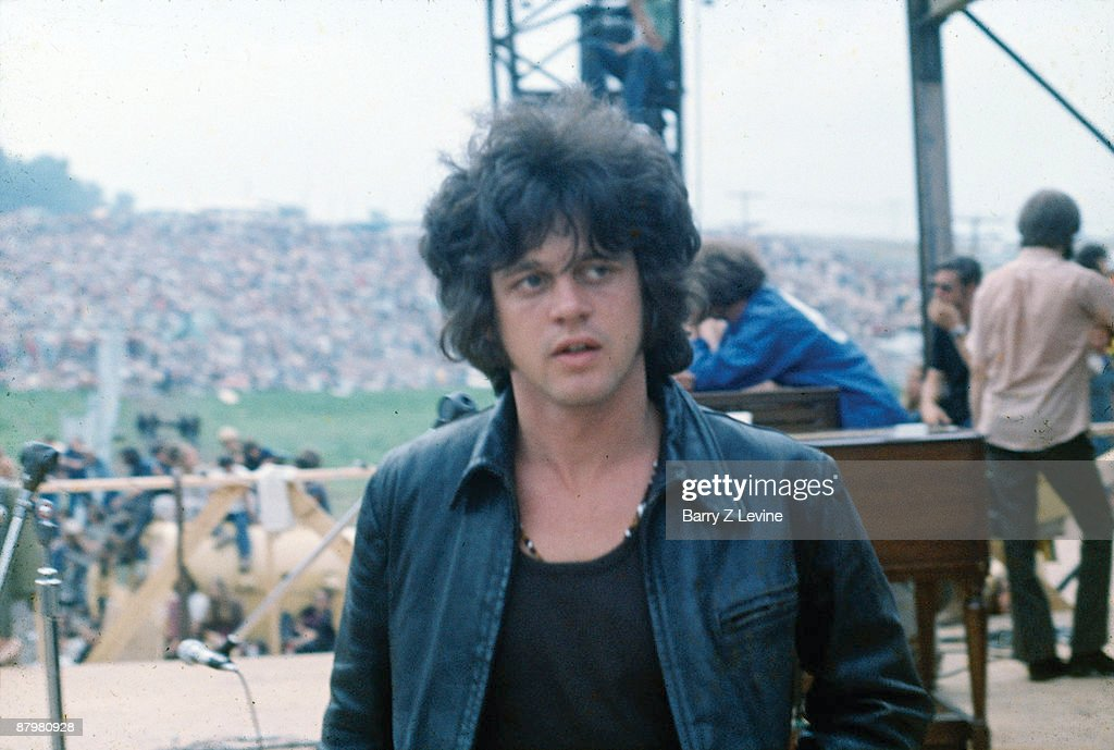 Gregg Rolie, keyboardist and founding member of the rock group of Santana stands on the stage at the Woodstock Music and Arts Fair in Bethel, New York, August 15 - 17 (and part of the 18th), 1969.