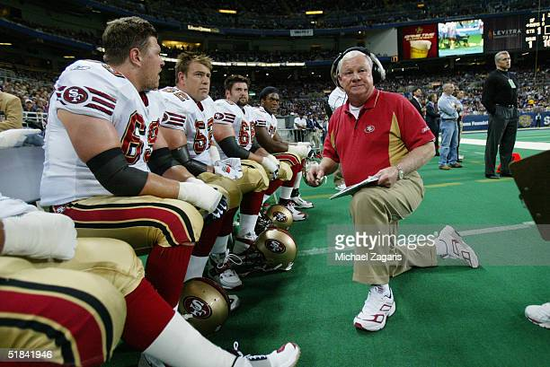 Gregg Smith addresses Kyle Kosier and Brock Gutierrez of the San Francisco 49ers during the game against the St Louis Rams at the Edward Jones Dome...