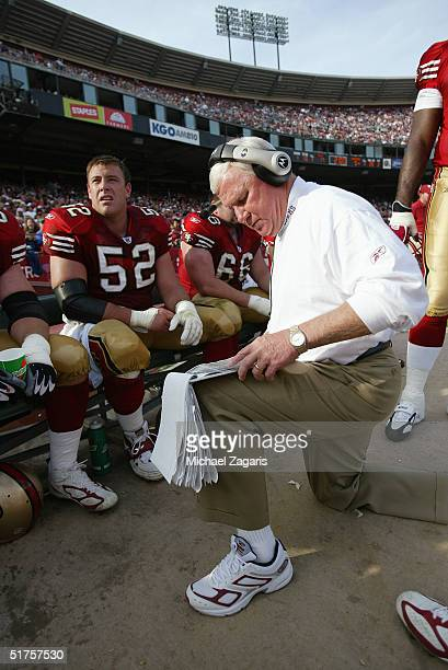 Gregg Smith meets with Brock Gutierrez of the San Francisco 49ers during the game against the Carolina Panthers at Monster Park on November 14 2004...