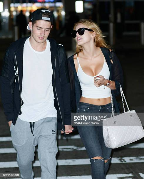 Gregg Sulkin and Bella Thorne are seen at JFK on July 29 2015 in New York City