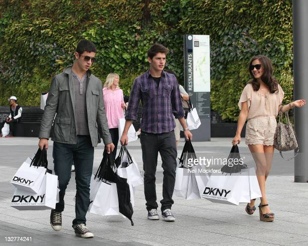 Gregg Sulkin and Electra Formosa and David Henrie from Disney's 'Wizards of Waverly Place' sighted shopping at DKNY in Westfield shopping centre at...