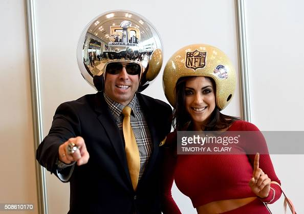 Gregg Wilson and Cynthia Renterie pose for pictures at the media center for the Super Bowl 50 at the Moscone Convention Center in San Francisco on...