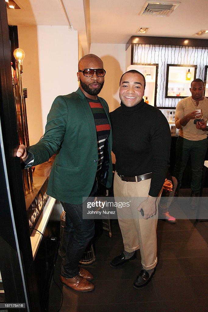 Greggory Ashe and Christian Alexander Mitchell attend the Reserv Concierge & Diptyque holiday shopping party at the Diptyque Store on November 29, 2012 in New York City.