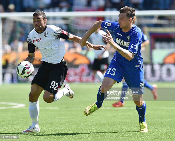 Gregoire Defrel of Cesena and Francesco Acerbi of Sassuolo in action during the Serie A match between AC Cesena and US Sassuolo Calcio at Dino...
