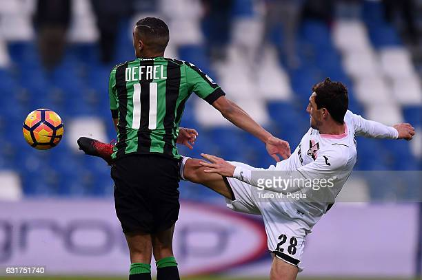 Gregoire Defrel of Sassuolo and Mato Jajalo of Palermo compete for the ball during the Serie A match between US Sassuolo and US Citta di Palermo at...
