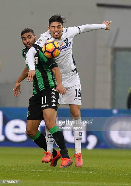 Gregoire Defrel of Sassuolo competes for the ball in air with Federico Barba of Empoli during the Serie A match between US Sassuolo and Empoli FC at...