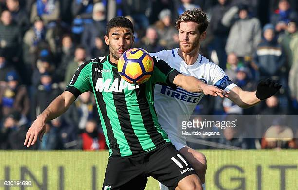 Gregoire Defrel of Sassuolo competes for the ball with Cristian Ansaldi of Inter during the Serie A match between US Sassuolo and FC Internazionale...
