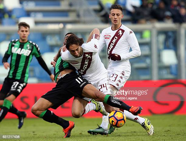 Gregoire Defrel of Sassuolo competes for the ball with Emiliano Moretti of Torino during the Serie A match between US Sassuolo and FC Torino at Mapei...