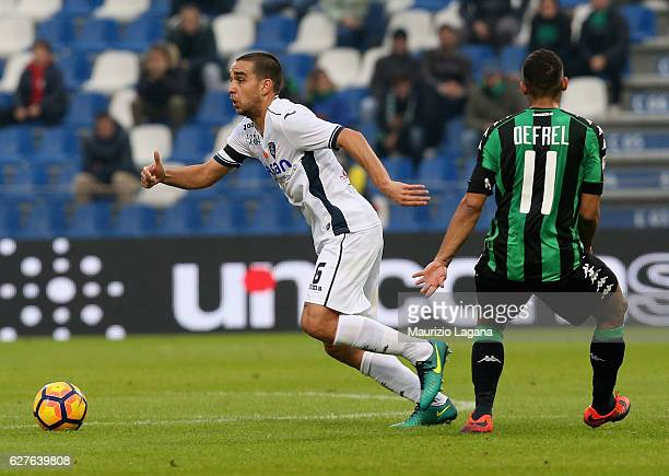 Gregoire Defrel of Sassuolo competes for the ball with Giuseppe Bellsci of Empoli during the Serie A match between US Sassuolo and Empoli FC at Mapei...