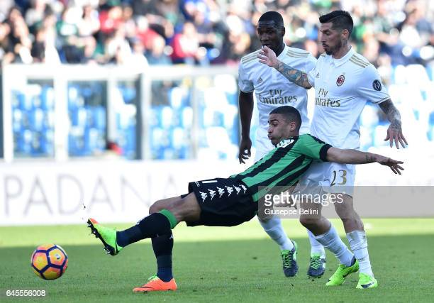 Gregoire Defrel of US Sassuolo and Jose Sosa of AC Milan in action during the Serie A match between US Sassuolo and AC Milan at Mapei Stadium Citta'...