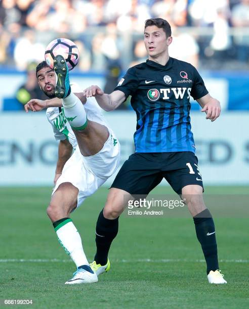 Gregoire Defrel of US Sassuolo Calcio competes for the ball with Mattia Caldara of Atalanta BC during the Serie A match between Atalanta BC and US...