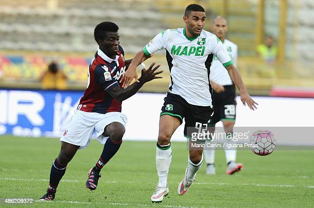 Gregoire Defrel of US Sassuolo Calcio competes the ball with Godfred Donsah of Bologna FC during the Serie A match between Bologna FC and US Sassuolo...