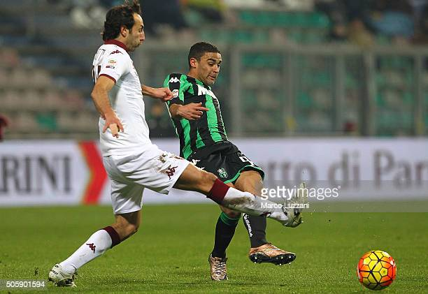 Gregoire Defrel of US Sassuolo Calcio is challenged by Emiliano Moretti of Torino FC during the Serie A match betweeen US Sassuolo Calcio and Torino...