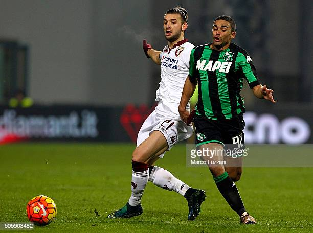 Gregoire Defrel of US Sassuolo Calcio is challenged by Silva Gaston of Torino FC during the Serie A match betweeen US Sassuolo Calcio and Torino FC...