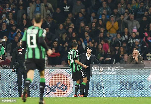 Gregoire Defrel of US Sassuolo celebrates with the injured Matteo Politano after scoring goal 11 during the Serie A match between SSC Napoli and US...