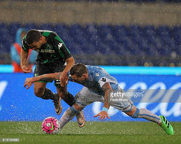 Gregoire Defrel of US Sassuolo competes for the ball with Lucas Biglia of SS Lazio during the Serie A match between SS Lazio and US Sassuolo Calcio...