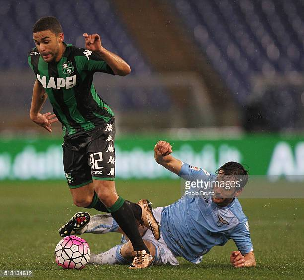 Gregoire Defrel of US Sassuolo competes for the ball with Marco Parolo of SS Lazio during the Serie A match between SS Lazio and US Sassuolo Calcio...