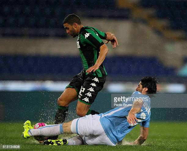 Gregoire Defrel of US Sassuolo competes for the ball with Milan Bisevac of SS Lazio during the Serie A match between SS Lazio and US Sassuolo Calcio...