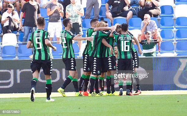 Gregoire Defrel of US Sassuolo is mobbed by team mates after scoring his his opening goal during the Serie A match between US Sassuolo and Udinese...