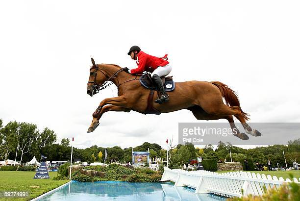 Gregoire Oberson ridding Wiske Van't Smeedsh of Switzerland clears the water jump during the Longines King George V Gold Cup at the Longines...