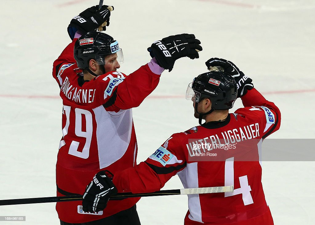 Gregor Baumgartner (L) of Austria celebrate with team mate Gerhard Unterluggauer (#4) his team's 1st goal during the IIHF World Championship group H match between Slovakia and Austria at Hartwall Areena on May 10, 2013 in Helsinki, Finland.