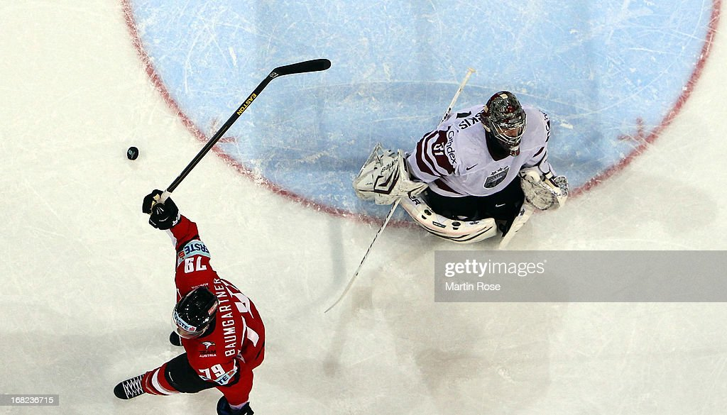 Gregor Baumgartner (L) of Austria celebrates a goal during the IIHF World Championship group H match between Austria and Latvia at Hartwall Areena on May 7, 2013 in Helsinki, Finland.