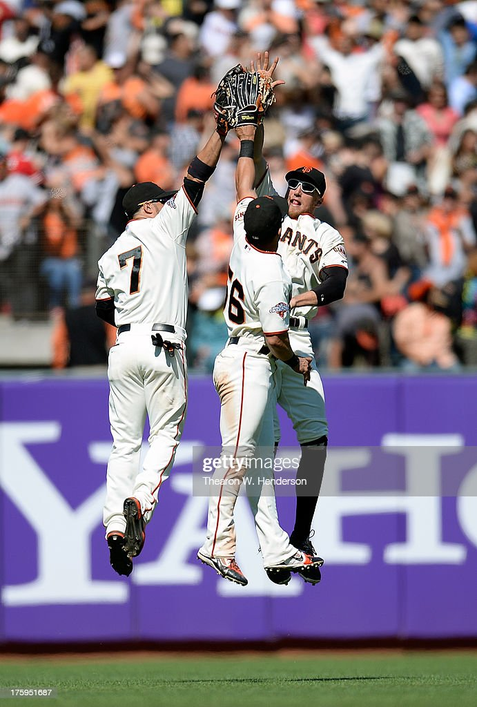 Gregor Blanco Andres Torres and Hunter Pence of the San Francisco Giants celebrate defeating the Baltimore Orioles 32 at ATT Park on August 10 2013...