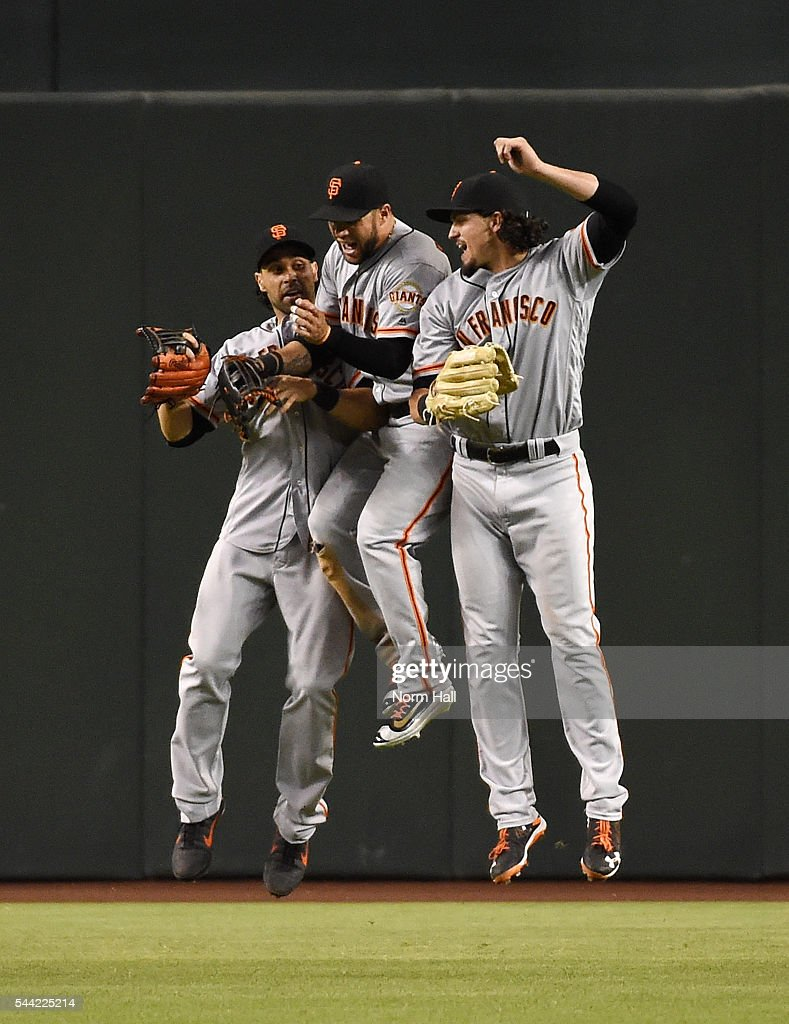 Gregor Blanco Angel Pagan and Jarrett Parker of the San Francisco Giants celebrate a 64 win against the Arizona Diamondbacks at Chase Field on July 1...