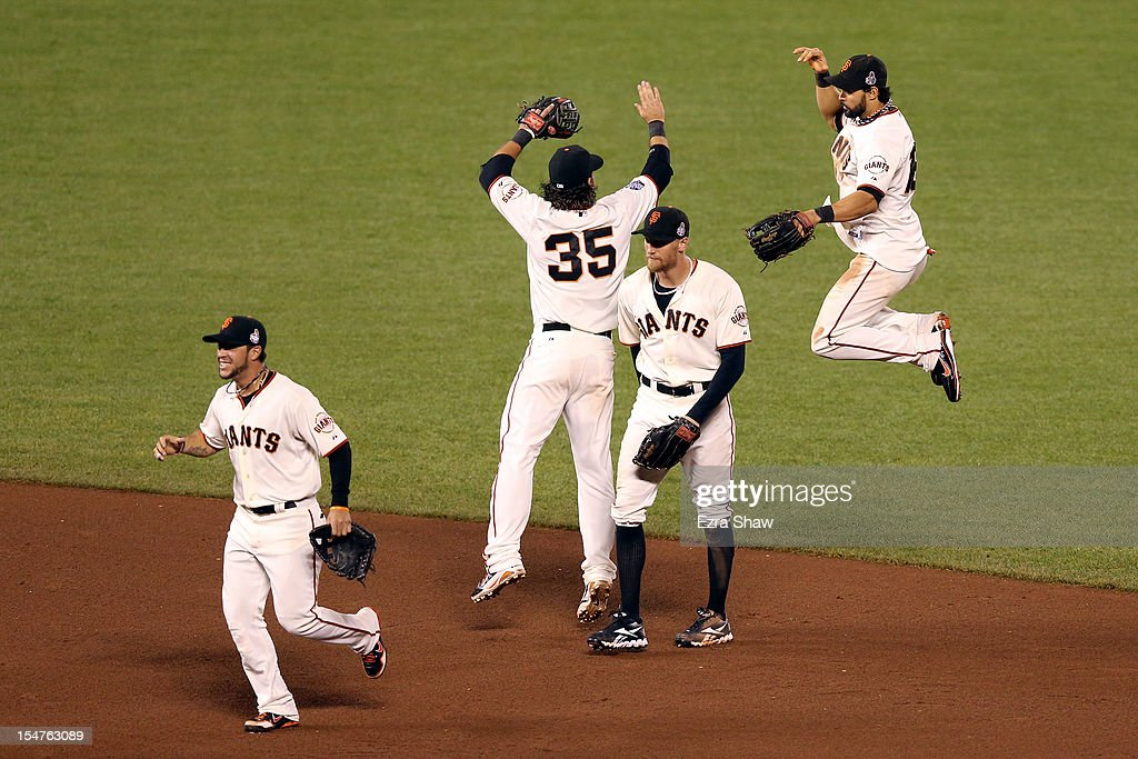 Gregor Blanco #7, Brandon Crawford #35, Hunter Pence #8 and Angel Pagan #16 of the San Francisco Giants celebrate after they won 2-0 against the Detroit Tigers during Game Two of the Major League Baseball World Series at AT&T Park on October 25, 2012 in San Francisco, California.