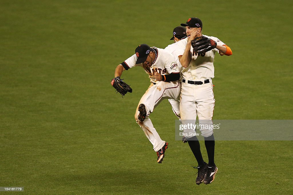<a gi-track='captionPersonalityLinkClicked' href=/galleries/search?phrase=Gregor+Blanco&family=editorial&specificpeople=4137600 ng-click='$event.stopPropagation()'>Gregor Blanco</a> #7 <a gi-track='captionPersonalityLinkClicked' href=/galleries/search?phrase=Hunter+Pence&family=editorial&specificpeople=757341 ng-click='$event.stopPropagation()'>Hunter Pence</a> #8 and <a gi-track='captionPersonalityLinkClicked' href=/galleries/search?phrase=Angel+Pagan&family=editorial&specificpeople=666596 ng-click='$event.stopPropagation()'>Angel Pagan</a> #16 of the San Francisco Giants celebrate their 7 to 1 win over the St. Louis Cardinals in Game Two of the National League Championship Series at AT&T Park on October 15, 2012 in San Francisco, California.