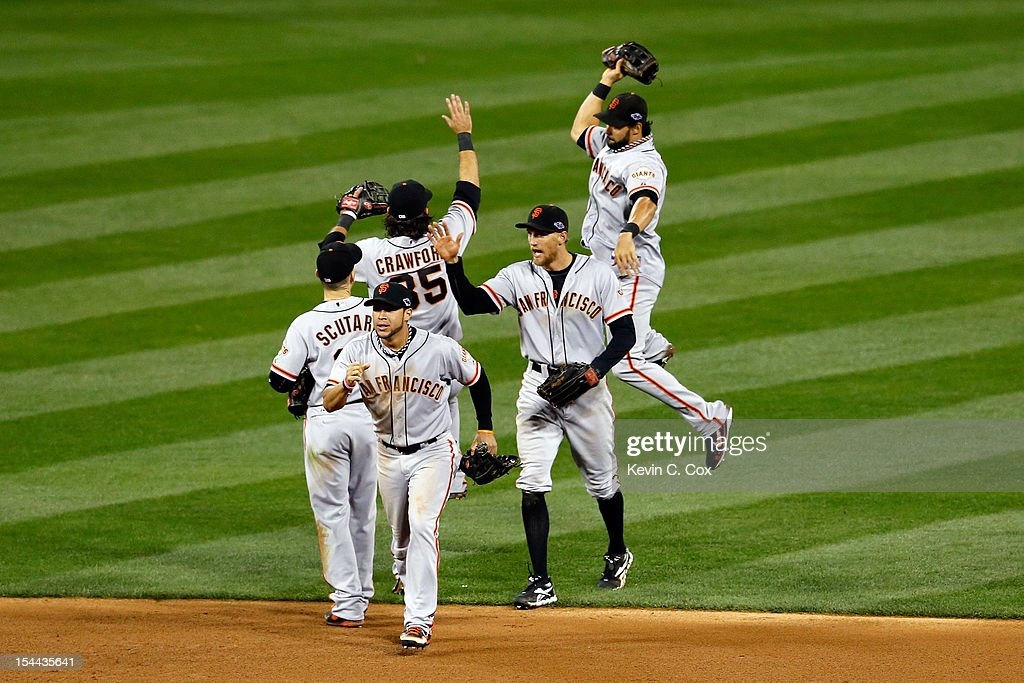 <a gi-track='captionPersonalityLinkClicked' href=/galleries/search?phrase=Gregor+Blanco&family=editorial&specificpeople=4137600 ng-click='$event.stopPropagation()'>Gregor Blanco</a> #7, <a gi-track='captionPersonalityLinkClicked' href=/galleries/search?phrase=Marco+Scutaro&family=editorial&specificpeople=239523 ng-click='$event.stopPropagation()'>Marco Scutaro</a> #19, <a gi-track='captionPersonalityLinkClicked' href=/galleries/search?phrase=Hunter+Pence&family=editorial&specificpeople=757341 ng-click='$event.stopPropagation()'>Hunter Pence</a> #8, <a gi-track='captionPersonalityLinkClicked' href=/galleries/search?phrase=Brandon+Crawford&family=editorial&specificpeople=5580312 ng-click='$event.stopPropagation()'>Brandon Crawford</a> #35 and Angel Pagan #16 of the San Francisco Giants celebrate the Giants 5-0 victory in Game Five of the National League Championship Series at Busch Stadium on October 19, 2012 in St Louis, Missouri.