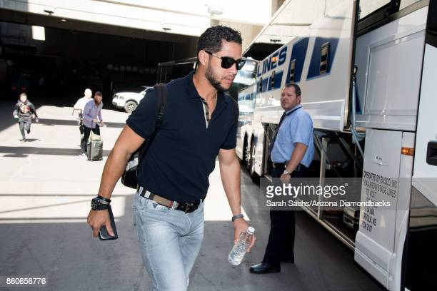 Gregor Blanco of the Arizona Diamondbacks boards the bus to Los Angeles for the National League Division Series against the Los Angeles Dodgers at...