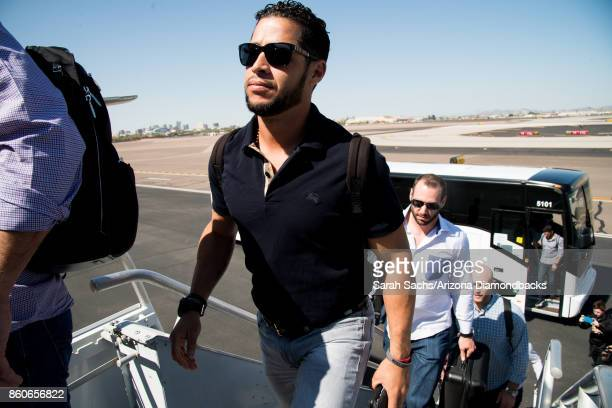 Gregor Blanco of the Arizona Diamondbacks boards the plane to Los Angeles for the National League Division Series against the Los Angeles Dodgers on...